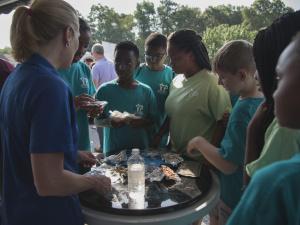 Participants examine astronaut food