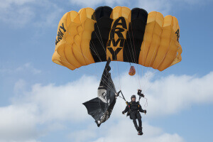 "Sgt. Nick Grimm, U.S. Army Parachute Team ""Golden Knights"" member, descends to the ground during the 2017 Joint Base Andrews Air Show"