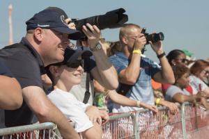 Audience members watch the U.S. Air Force Thunderbirds aerial performance during the 2017 JBA Air Show.